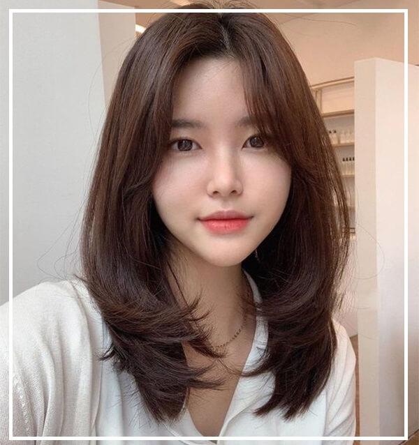 Tóc ngắn layer nữ mặt trái xoan