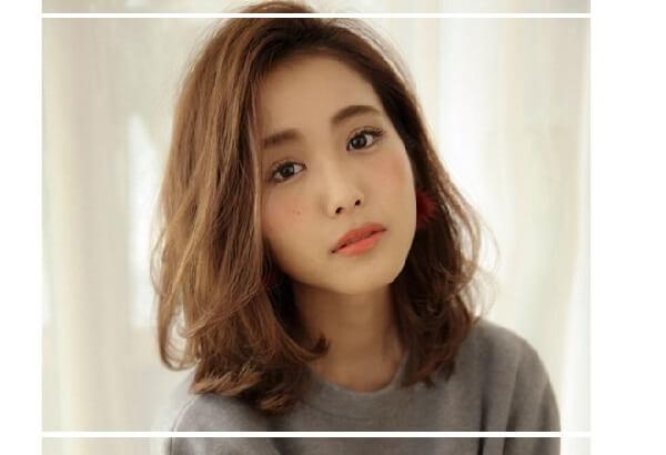Kiểu tóc tỉa layer nữ ngắn uốn cụp